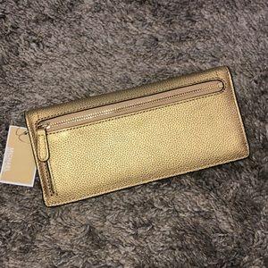 "Michael Kors Bags - Michael Kors ""Hayes"" Gold Flat Leather Wallet"